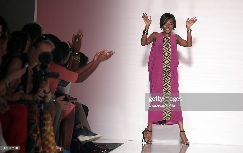 Designer Christie Brown acknowledges the audience during It's Ethical Fashion 'Bring Africa to Rome' catwalk collection S/S 2014 fashion show as part of AltaRoma AltaModa Fashion Week at Santo Spirito In Sassia on July 7, 2013 in Rome, Italy.