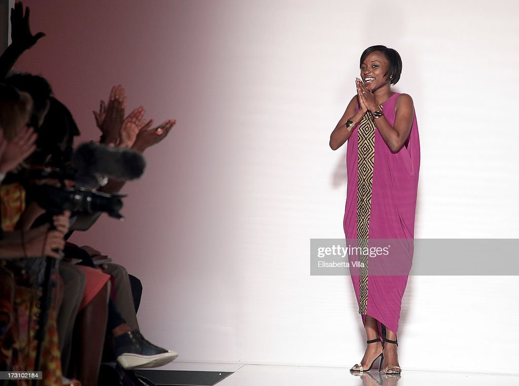Designer Christie Brown acknowledges the audience during the Ethical Fashion 'Bring Africa to Rome' catwalk collection S/S 2014 fashion show as part of AltaRoma AltaModa Fashion Week at Santo Spirito In Sassia on July 7, 2013 in Rome, Italy.