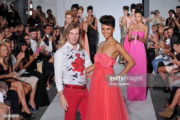 Designer Christophe Guillarme acknowledges the audience with Miss Prestige Nationale Auline Grac during the Christophe Guillarme show as part of...