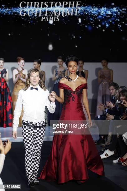 Designer Christophe Guillarme and Miss France 2014 Flora Coquerel walk the runway during the Christophe Guillarme show as part of the Paris Fashion...