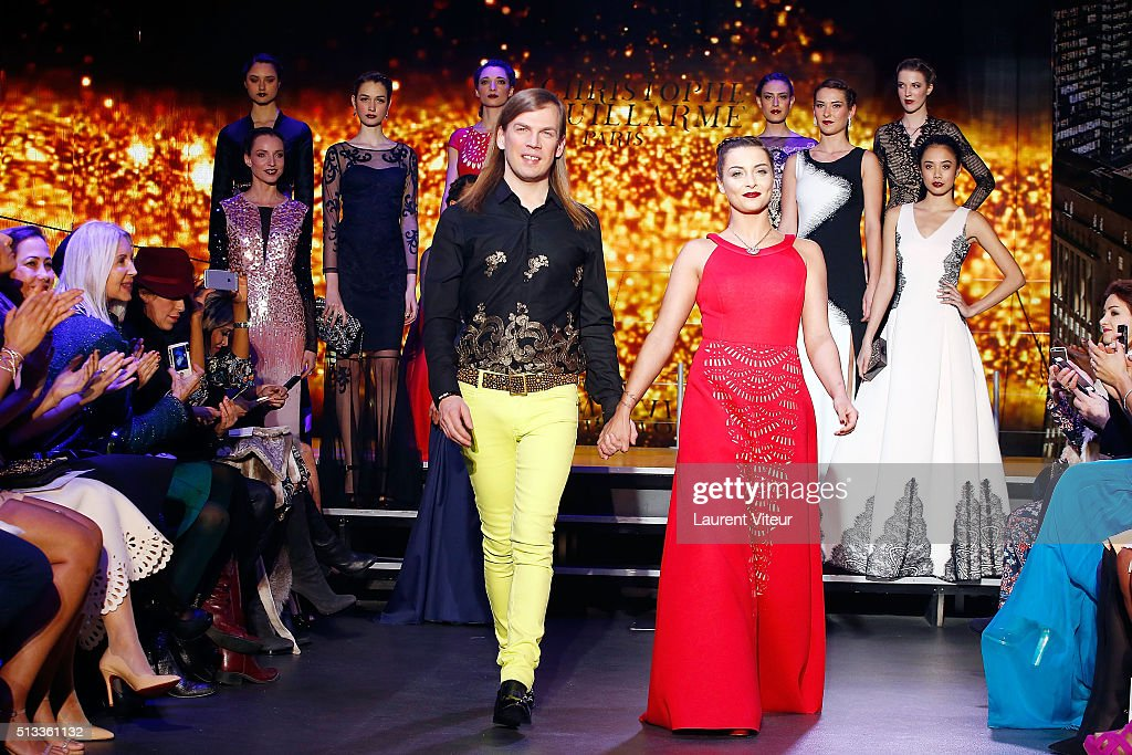 Designer Christophe Guillarme and Singer Priscilla Betti walk the runway for Final during the Christophe Guillarme show as part of the Paris Fashion...