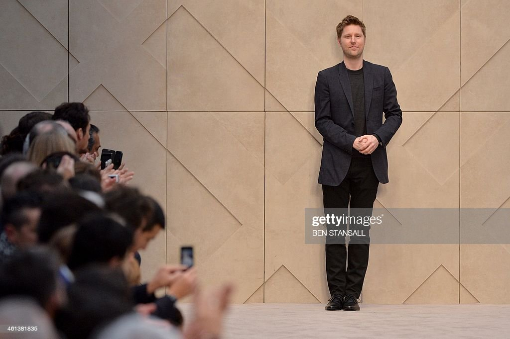 Designer Christopher Bailey acknowledges the audience following the Burberry Prorsum Autumn/Winter 2014 London Collections Men fashion event in...