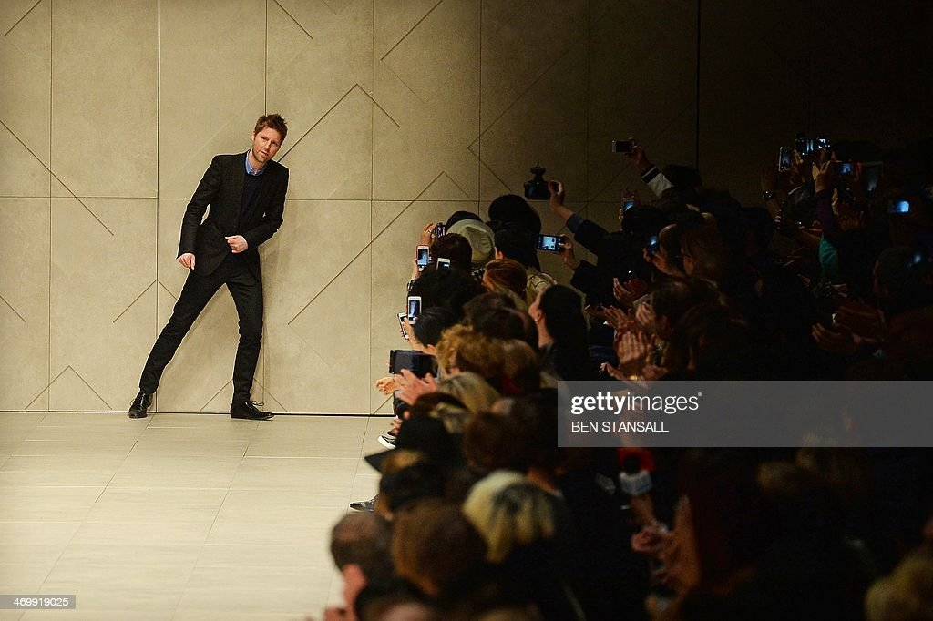 Designer Christopher Bailey acknowledges the audience following the Burberry Prorsum show during the 2014 Autumn / Winter London Fashion Week in...