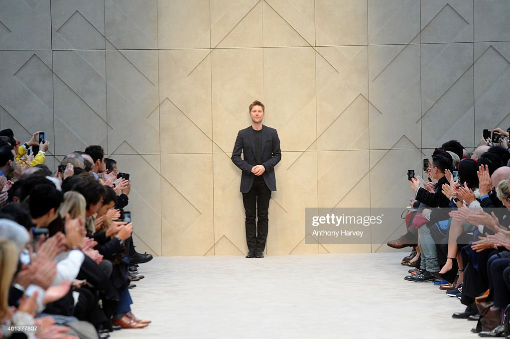Designer Christopher Bailey appears at the end of the runway at the Burberry AW14 Menswear Show at Kensington Gardens on January 8 2014 in London...