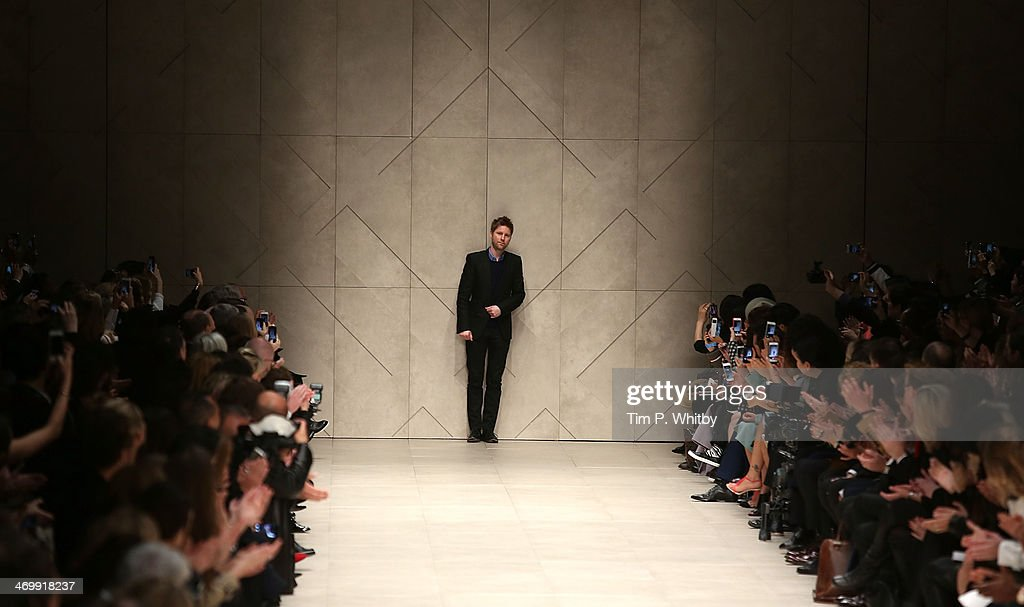 Designer Christopher Bailey on the runway at the Burberry Prorsum show at London Fashion Week AW14 at Perks Fields Kensington Gardens on February 17...