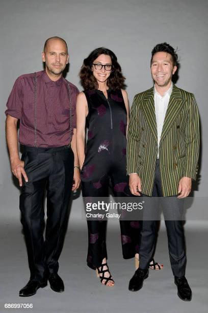Designer Claude Morais stylist Elizabeth Stewart and designer Brian Wolk at the Wolk Morais Collection 5 Fashion Show at Yamashiro on May 22 2017 in...