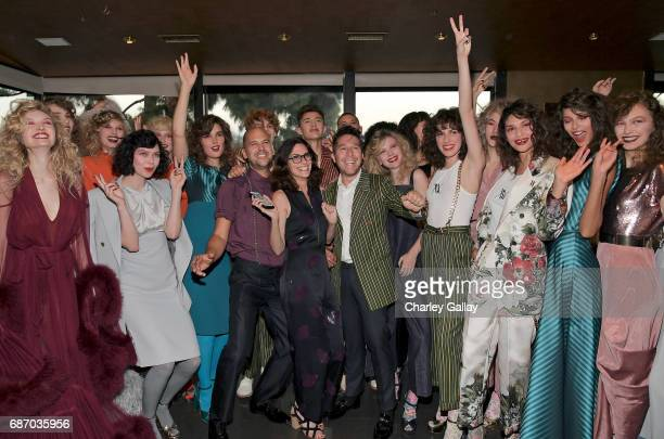 Designer Claude Morais stylist Elizabeth Stewart and designer Brian Wolk with models at the Wolk Morais Collection 5 Fashion Show on May 22 2017 in...