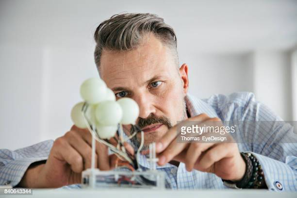 Designer Concentrating While Carefully Building Mockup
