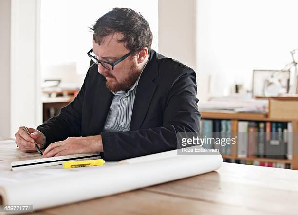 Designer corrects plans