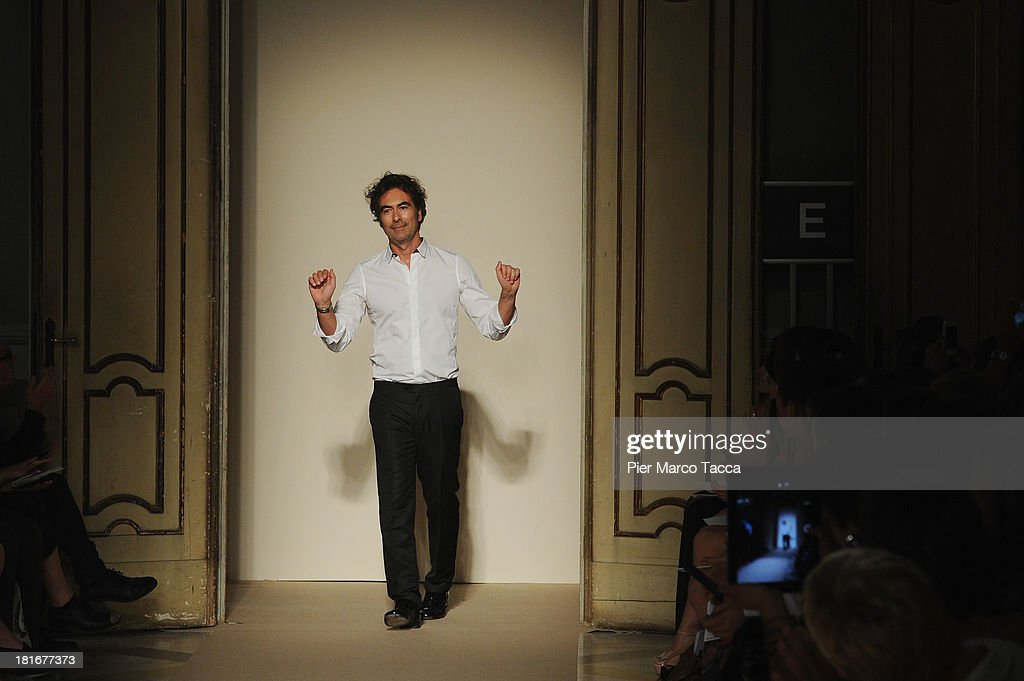 Designer Cristiano Burani acknowledges the applause of the audience after the Cristiano Burani show as a part of Milan Fashion Week Womenswear Spring/Summer 2014 at on September 23, 2013 in Milan, Italy.