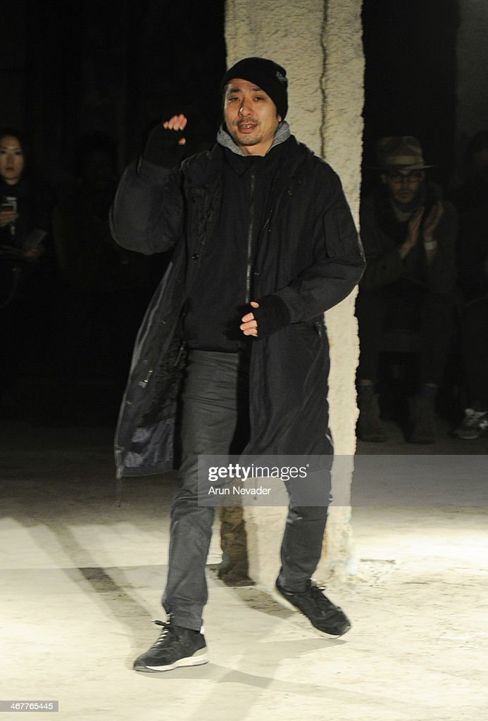 Designer Daisuke Obana appears on the runway at the N Hoolywood fashion show during MercedesBenz Fashion Week Fall 2014 at JP Morgan Chase on...