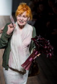 Designer Dame Vivienne Westwood stands on the runway after the Vivienne Westwood Red Label show during London Fashion Week SS14 at the German...