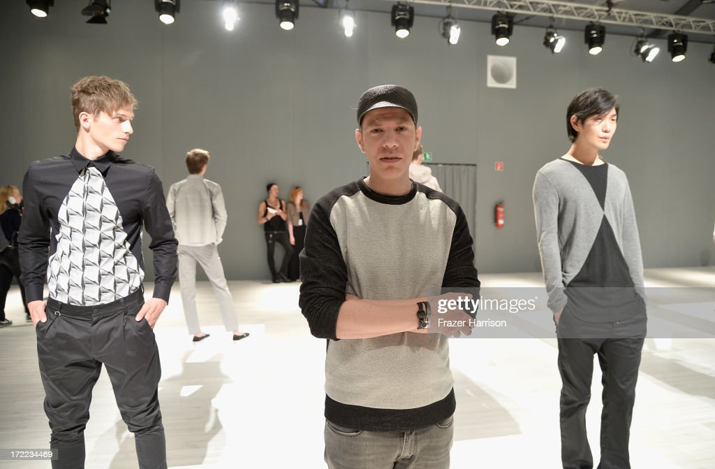 Designer Daniel Blechman (C) attends Sopopular show during Mercedes-Benz Fashion Week Spring/Summer 2014 at Brandenburg Gate on July 2, 2013 in Berlin, Germany.