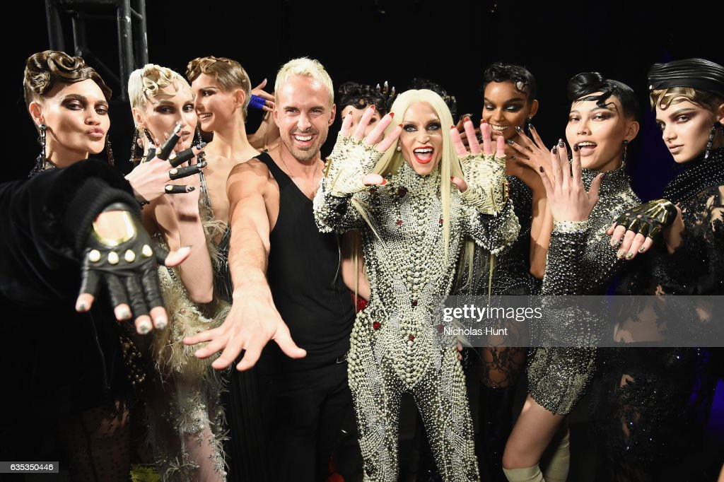 Designer David Blond and Phillipe Blond pose with models backstage for the The Blonds collection during, New York Fashion Week: The Shows at Gallery 1, Skylight Clarkson Sq on February 14, 2017 in New York City.
