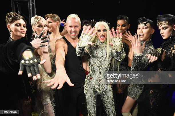 Designer David Blond and Phillipe Blond pose with models backstage for the The Blonds collection during New York Fashion Week The Shows at Gallery 1...