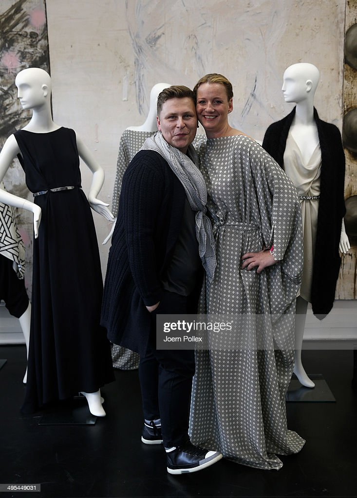 Designer Dawid Tomaszewki (L) and <a gi-track='captionPersonalityLinkClicked' href=/galleries/search?phrase=Jenny+Falckenberg&family=editorial&specificpeople=7824306 ng-click='$event.stopPropagation()'>Jenny Falckenberg</a> pose during the 'Dawid Tomaszewki Pop-Up Store Opening' on June 3, 2014 in Hamburg, Germany.