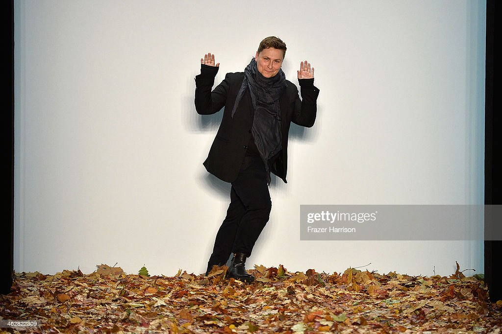 Designer Dawid Tomaszewski acknowledges the audience at the Dawid Tomaszewski show during Mercedes-Benz Fashion Week Autumn/Winter 2014/15 at Brandenburg Gate on January 15, 2014 in Berlin, Germany.