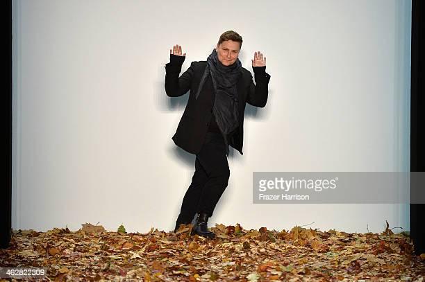 Designer Dawid Tomaszewski acknowledges the audience at the Dawid Tomaszewski show during MercedesBenz Fashion Week Autumn/Winter 2014/15 at...