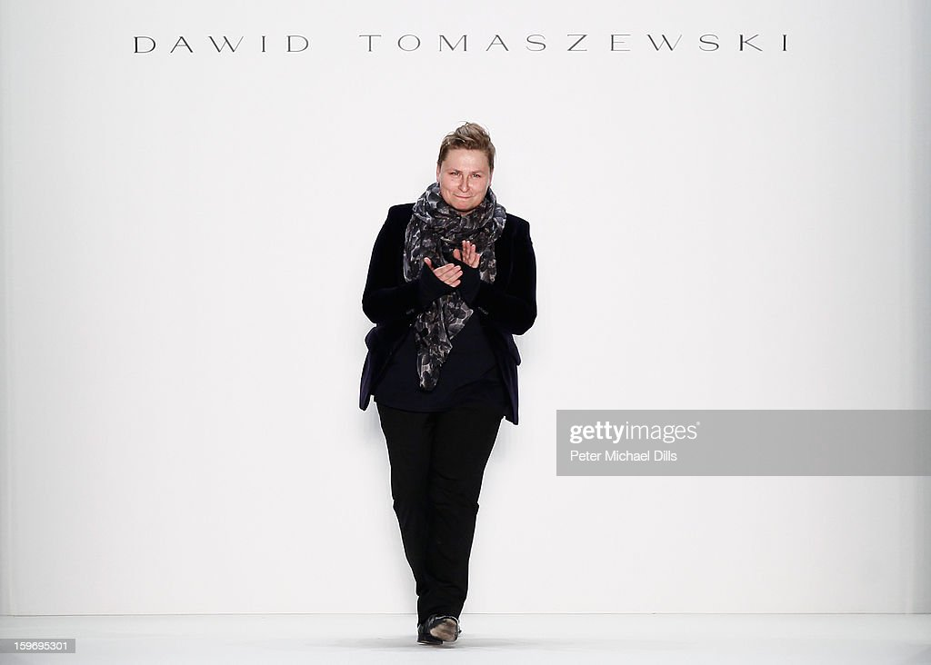 Designer Dawid Tomaszewski walks the runway at Dawid Tomaszewski Autumn/Winter 2013/14 fashion show during Mercedes-Benz Fashion Week Berlin at Brandenburg Gate on January 18, 2013 in Berlin, Germany.