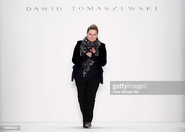 Designer Dawid Tomaszewski walks the runway at Dawid Tomaszewski Autumn/Winter 2013/14 fashion show during MercedesBenz Fashion Week Berlin at...