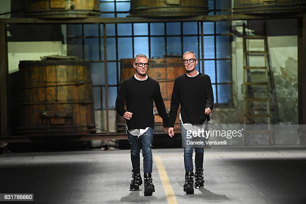 Designer Dean and Dan Caten acknowledge the audience at the end of the Dsquared2 show during Milan Men's Fashion Week Fall/Winter 2017/18 on January...