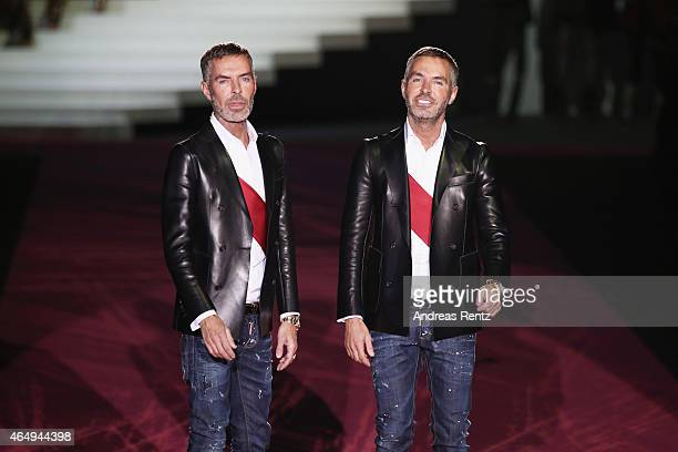 Designer Dean Caten and Dan Caten acknowledges the applause of the public after the Dsquared2 show during the Milan Fashion Week Autumn/Winter 2015...