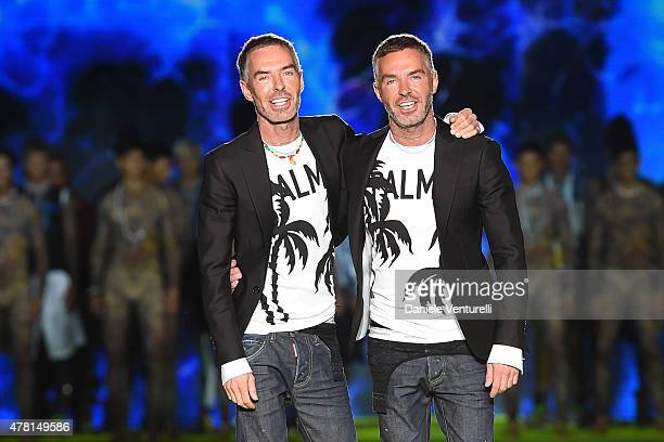 Designer Dean Caten and Dan Caten acknowledges the applause of the audience after the DSquared2 of Milan fashion show as part of Milan Men's Fashion...