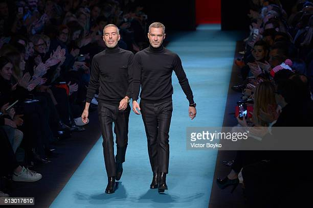 Designer Dean Caten and Dan Caten acknowledges the applause of the audience after the Dsquared2 show during Milan Fashion Week Fall/Winter 2016/17 on...
