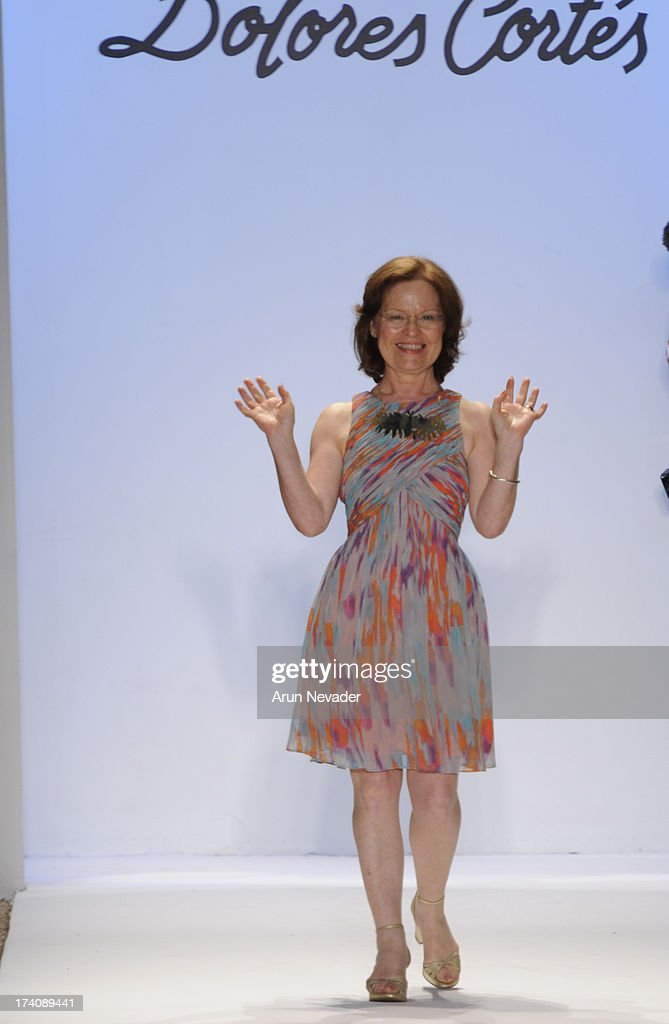 Designer Delores Cortes appears on the runway at the end of her show during Mercedes-Benz Fashion Week Swim 2014 - Runway at Raleigh Hotel on July 19, 2013 in Miami Beach, Florida.