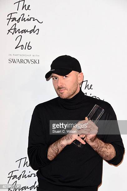 Designer Demna Gvasalia poses in the winners room after winning the International RTW Designer Award at The Fashion Awards 2016 at Royal Albert Hall...