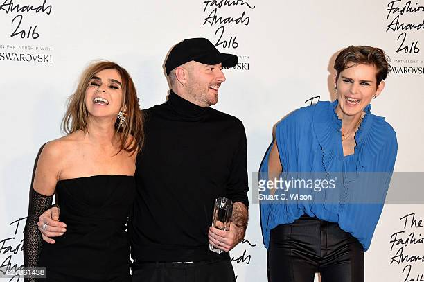 Designer Demna Gvasalia poses in the winners room with Carine Roitfeld and Stella Tennant after winning the International RTW Designer Award at The...