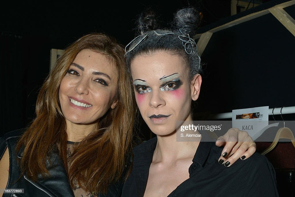 Designer Deniz Berdan (L) poses with a model backstage ahead of the DB Berdan show during Mercedes-Benz Fashion Week Istanbul Fall/Winter 2013/14 at Antrepo 3 on March 15, 2013 in Istanbul, Turkey.