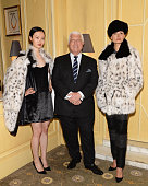 Designer Dennis Basso poses with models wearing his lattest collection at 'High Tea High Fashion with Dennis Basso' benefiting New York Botanical...