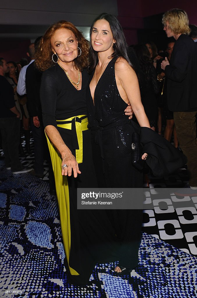 Designer Diane Von Furstenberg and actress Demi Moore, wearing Diane Von Furstenberg, attend Diane Von Furstenberg's Journey of A Dress Exhibition Opening Celebration at May Company Building at LACMA West on January 10, 2014 in Los Angeles, California.
