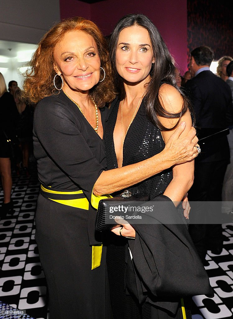 Designer Diane Von Furstenberg (L) and actress Demi Moore, wearing Diane Von Furstenberg, attend Diane Von Furstenberg's Journey of A Dress Exhibition Opening Celebration at May Company Building at LACMA West on January 10, 2014 in Los Angeles, California.