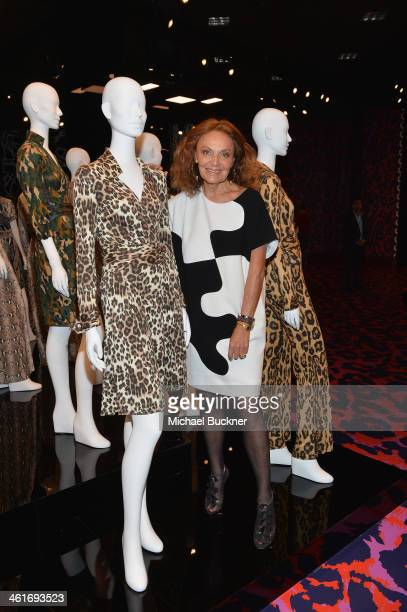 Designer Diane von Furstenberg poses for photographers in front of her collection of Wrap Dresses during the Journey of A Dress Exhibition at LACMA...