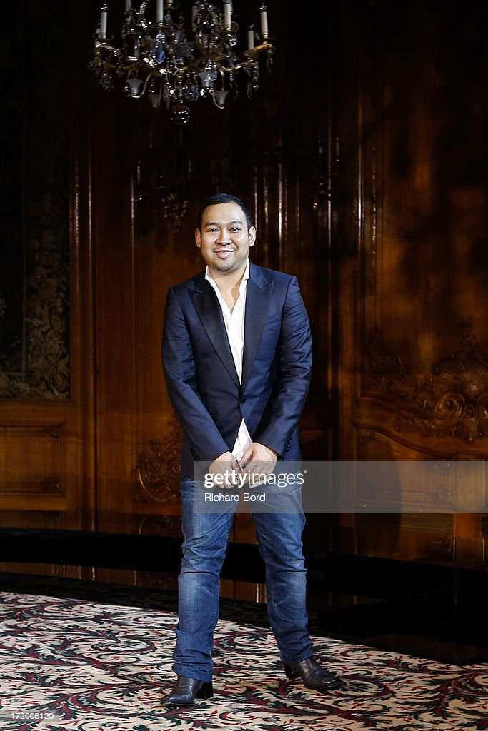 Designer Didit Hediprasetyo walks the runway during the Didit Hediprasetyo show as part of Paris Fashion Week Haute-Couture Fall/Winter 2013-2014 at Hotel Le Bristol on July 4, 2013 in Paris, France.