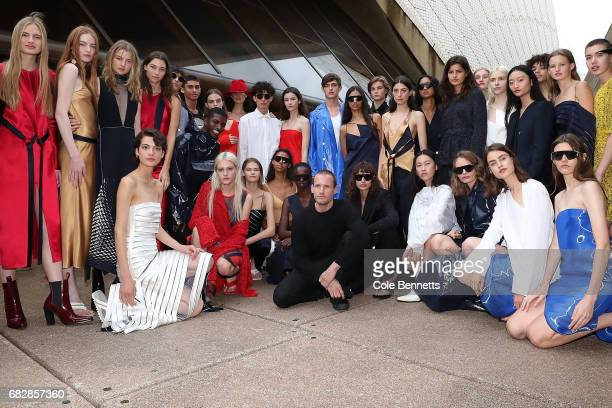 Designer Dion Lee poses for a photo with models following the MercedesBenz Presents Dion Lee show at MercedesBenz Fashion Week Resort 18 Collections...