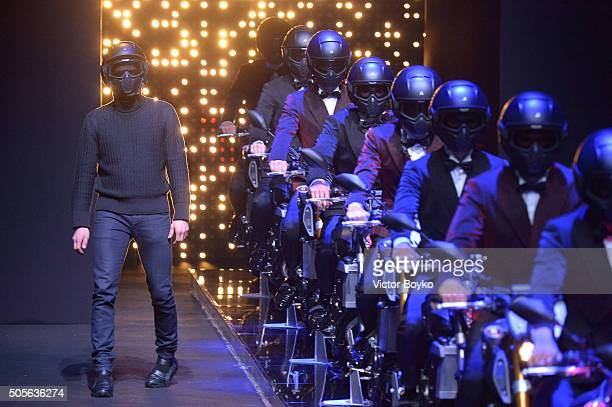 Designer Dirk Bikkembergs acknowledges the applause of the public after the Dirk Bikkembergs show during Milan Men's Fashion Week Fall/Winter 2016/17...