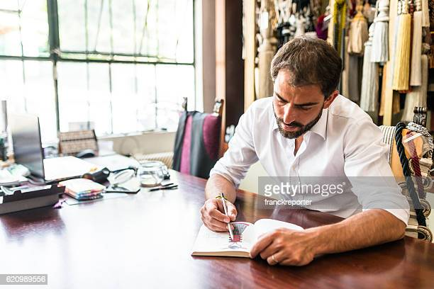 designer doing a sketch on his factory