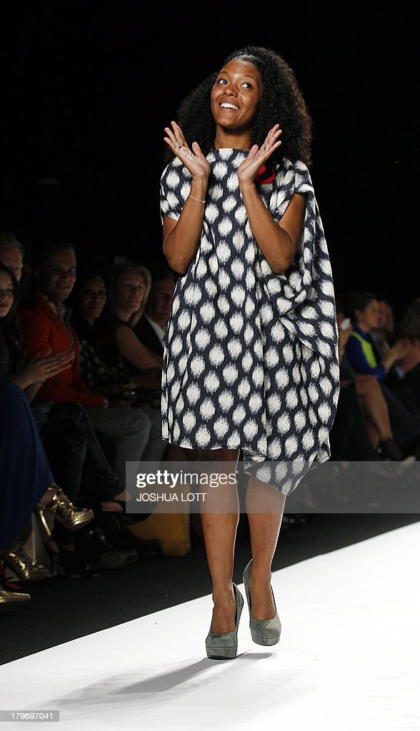 Designer Dom Streater acknowledges the crowd during the Project Runway fashion show at the Mercedes-Benz Fashion Week Spring 2014 collections on September 6, 2013 in New York. AFP PHOTO/Joshua Lott