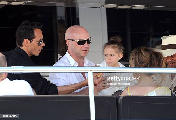 Designer Domenico Dolce holds Emme Maribel Muniz the daughter of Marc Anthony and Jennifer Lopez during the 63rd Cannes Film Festival on May 23 2010...