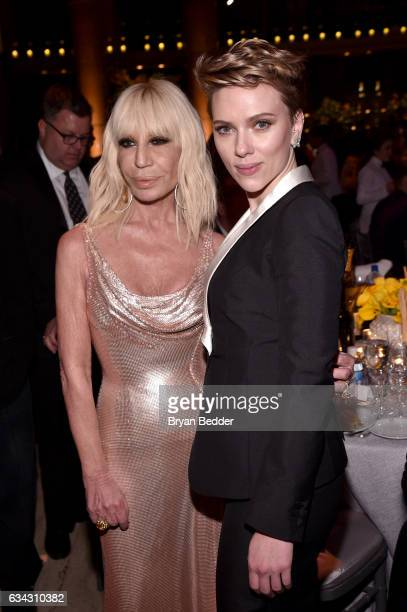 Designer Donatella Versace and actress Scarlett Johansson attend as Moet Chandon Toasts to the amfAR New York Gala At Cipriani Wall Street at...