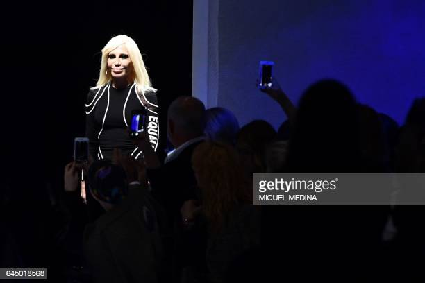 TOPSHOT Designer Donatella Versace greets the audience at the end of the show for fashion house Versace during the Women's Fall/Winter 2017/2018...