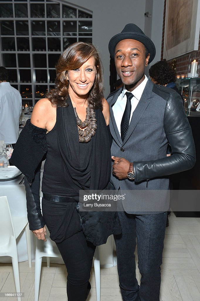 Designer Donna Karan and Singer <a gi-track='captionPersonalityLinkClicked' href=/galleries/search?phrase=Aloe+Blacc&family=editorial&specificpeople=4340598 ng-click='$event.stopPropagation()'>Aloe Blacc</a> attend IWC and Tribeca Film Festival Celebrate 'For the Love of Cinema' on April 18, 2013 in New York City.
