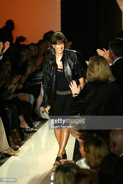 Designer Donna Karan greets guests at her Spring/Summer 2004 fashion show at Bryant Park during the 7th on Sixth MercedesBenz New York Fashion Week...