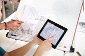 Designer drawing plans from a digital tablet