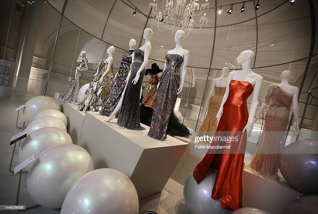 Designer dresses are displayed at the 'Ballgowns British Glamour Since 1950' exhibition at The Victoria and Albert Museum on May 15 2012 in London...