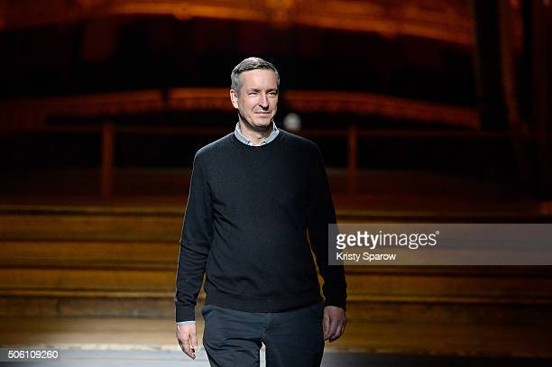 Designer Dries Van Noten acknowledges the audience during the Dries Van Noten Menswear Fall/Winter 20162017 show as part of Paris Fashion Week on...
