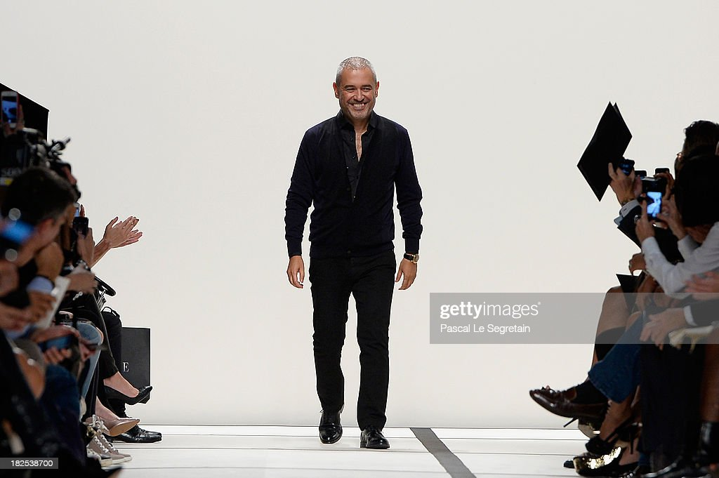 Designer Elie Saab acknowledges the applause of the audience after the Elie Saab show as part of the Paris Fashion Week Womenswear Spring/Summer 2014 at Espace Ephemere Tuileries on September 30, 2013 in Paris, France.